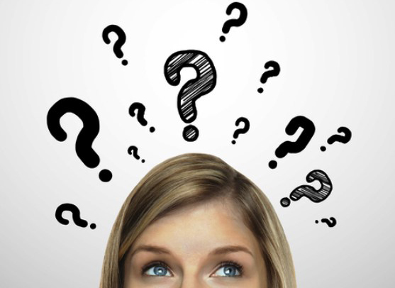 woman with question marks above her head