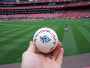hand holding a home run baseball