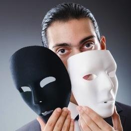 guy holding 2 masks